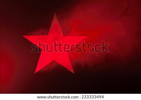 Red Star. Hole cut in cardboard, smoke machine and spotlight. The image may appear noisy, but that is the texture of the smoke. - stock photo