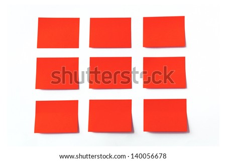Red sticky notes on white background - stock photo
