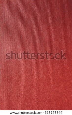 Red still life paper texture background with vertical parallel lines, full frame. Close up detail of textured sheet of paper blank page with monotone bright red organic art paper. Background stripes.