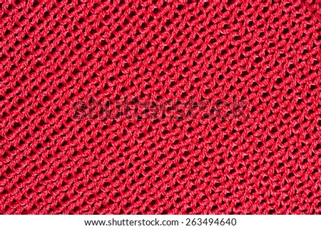 Red stockinet background texture - stock photo