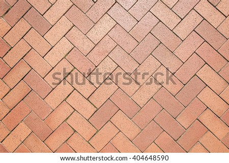 Red stone pavement background texture close up