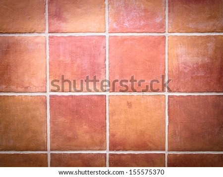 Red stone wall tile with white grout - stock photo