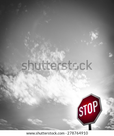 red stop sign with blue sky and clouds (20) - stock photo