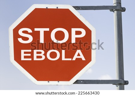 red stop sign with the words stop EBOLA. Concept against spreading Ebola infection and disease - stock photo