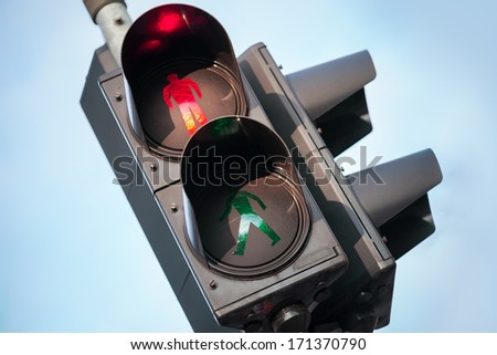 Red stop signal of urban street pedestrian traffic light - stock photo