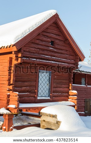 red storage house in winter