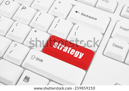 Red strategy keyboard button on white keyboard - stock photo