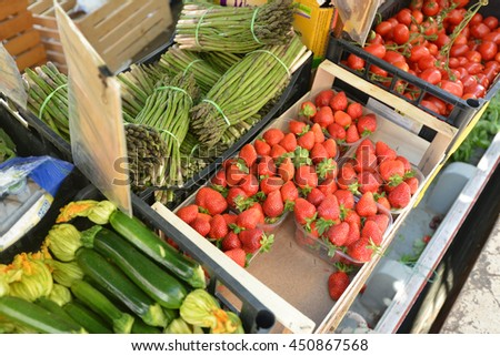 red strawberries and vegetables on counter