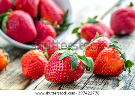 red strawberries on wooden table - stock photo