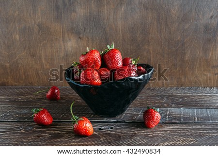 red strawberries, strawberries on a brown background,  strawberries in ceramic ware, bowl with strawberries, fragrant strawberries, ripe strawberries, freshly picked strawberries - stock photo