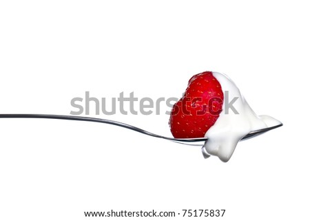 Red strawberry and white ice cream on spoon. Isolated on white