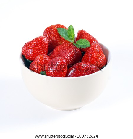 red strawberry in bowl on white background - stock photo
