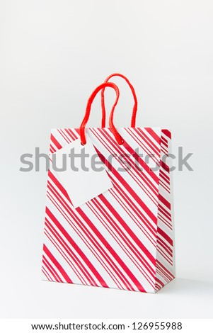Red stripe shopping bag isolated on white background - stock photo