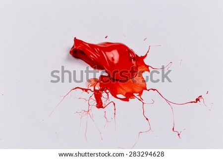 Red stroke of the paint brush on white paper - stock photo