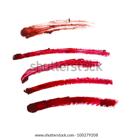 red strokes from lipstick on white background - stock photo