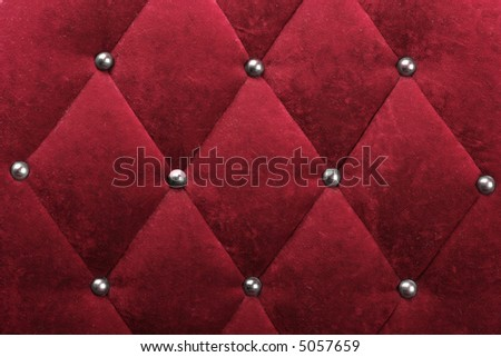 red stylish fabric with knobs - stock photo