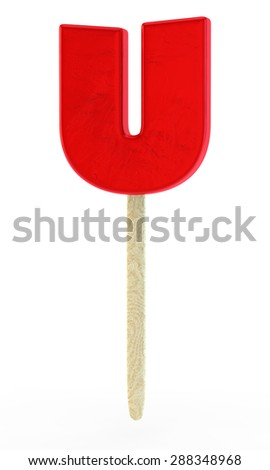 red sugar candy in the form of a letter U on a wooden stick - stock photo
