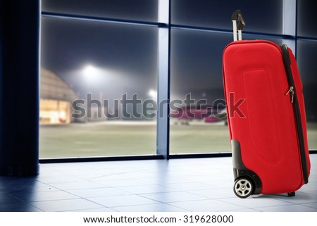 red suitcase and window  - stock photo