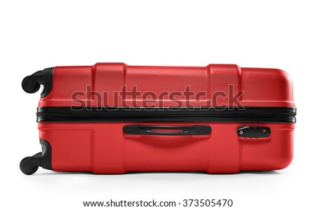 red suitcase plastic. lying horizontally - stock photo
