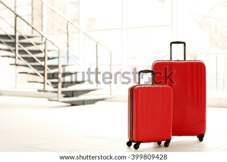 Red suitcases indoors - stock photo