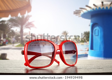red sunglasses and summer day  - stock photo
