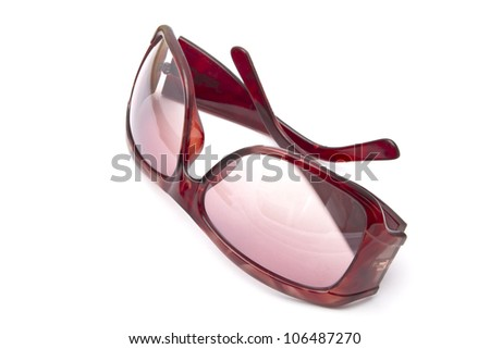 Red sunglasses closeup on white background