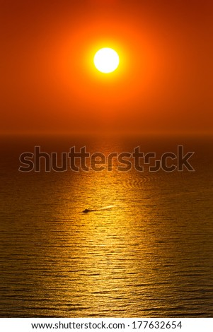 Red sunset over calm sea - stock photo