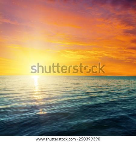 red sunset over dark sea - stock photo