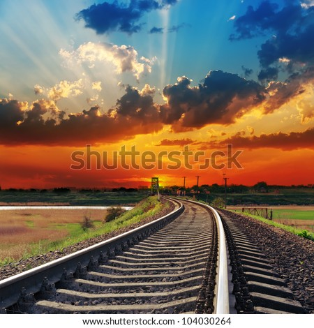 red sunset over railway to horizon - stock photo