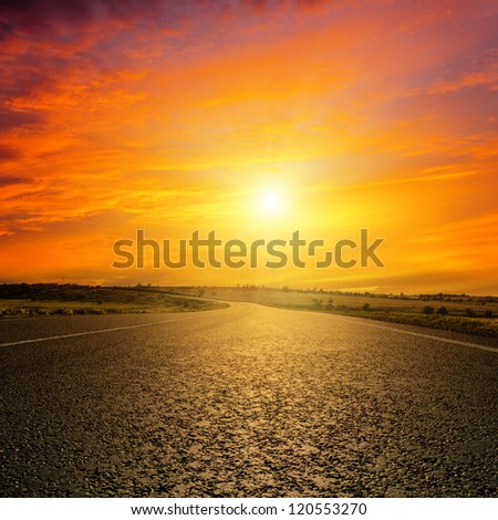red sunset over road - stock photo