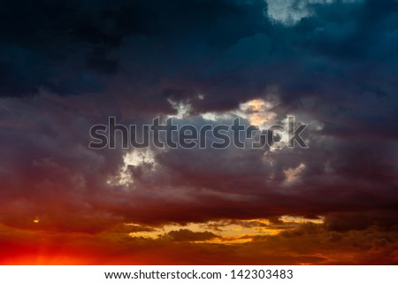 Red sunset with black clouds