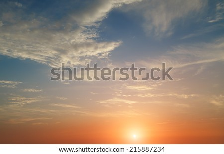 red sunset with clouds photographed by a telephoto lens - stock photo