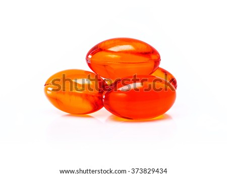 Red supplement capsules isolated on white background - stock photo