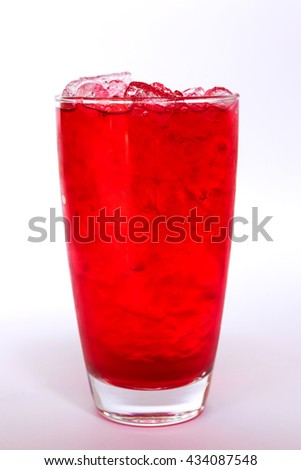 Red sweet drink on ice cubes isolated on white background
