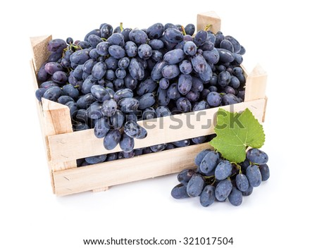 Red table grapes (Vitis) in wooden crate on white - stock photo