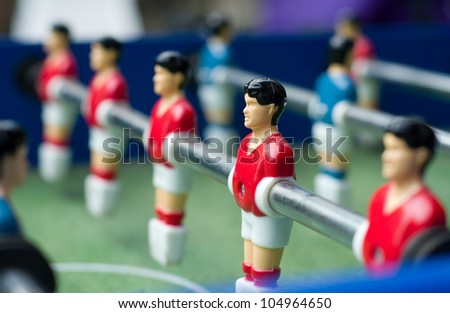 Red table soccer players with limited dof - stock photo