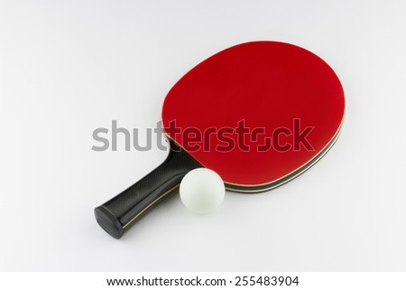 Red table tennis (ping-pong) racket and white ball isolated on white background - stock photo
