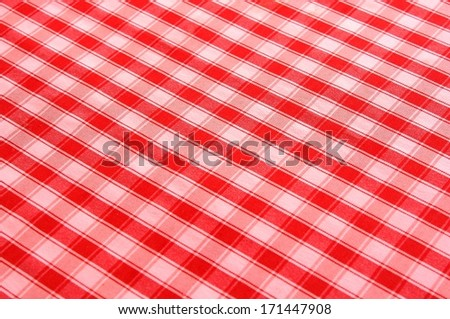 Red tablecloth background - stock photo