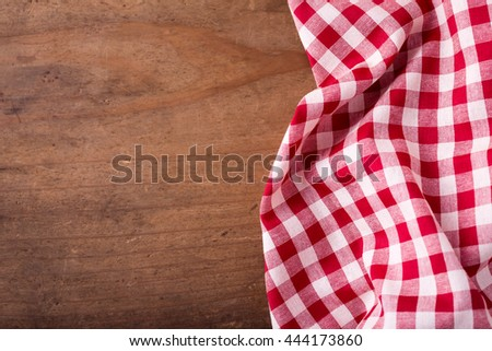red tablecloth on wooden background ,crumpled red tablecloth on wooden background - stock photo