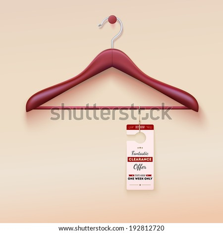Red tag with special offer sign hanging on wooden hanger - stock photo