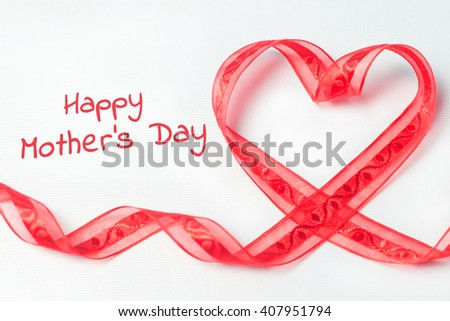 Red tape in the form of heart with swirls . On a white textured background. With copy space. Shallow DOF