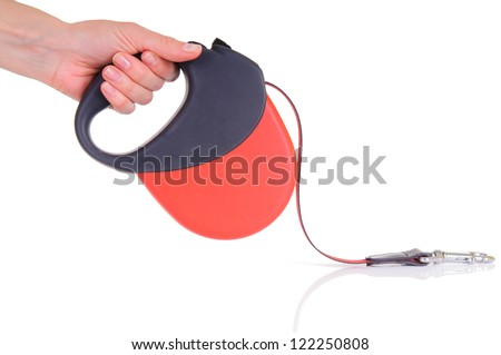 red tape leash for dogs. human hand holding. isolated on white background. close-up - stock photo