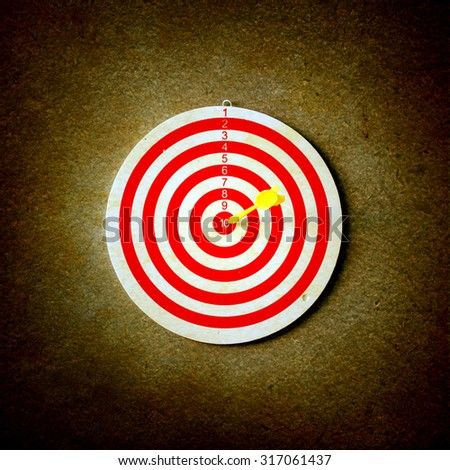 Red target aim, symbol of goal and objective over gray grunge background, business concept