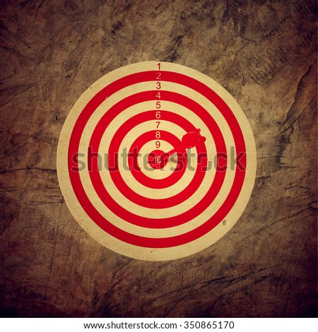 Red target aim, symbol of goal and objective over grunge background, business concept