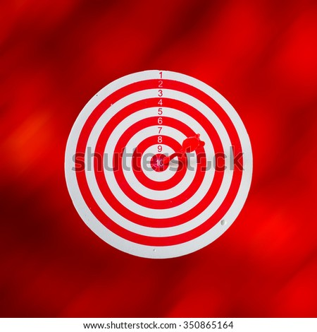 Red target aim, symbol of goal and objective over red abstract background, business concept