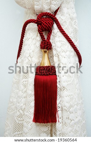 Red tassel on the drapery
