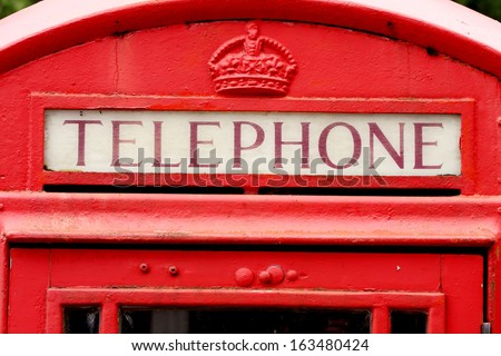 Red telephone booth in Scotland, UK. - stock photo