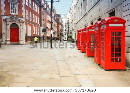 Red telephone booths in London UK. Filtered colors style.