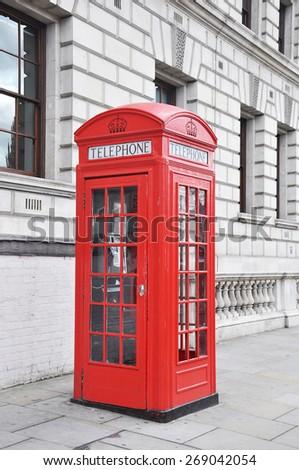 Red telephone box in London, UK - stock photo