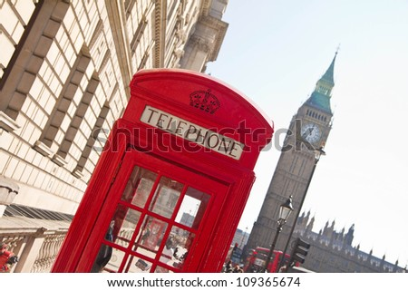 Red telephone box with Big Ben in background, London, UK - stock photo